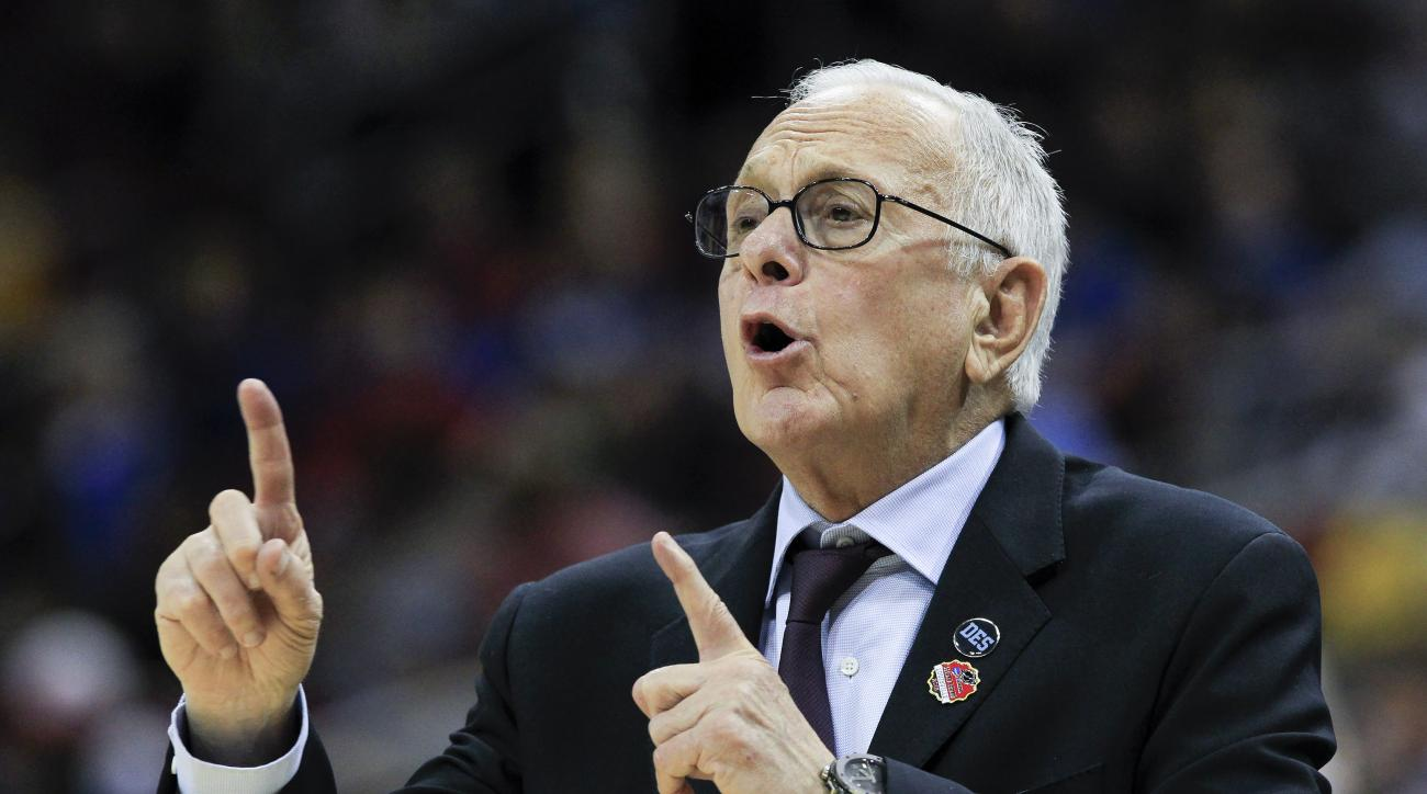FILE - In this March 19, 2015, file photo, SMU head coach Larry Brown directs his team against UCLA during the first half in the second round of the NCAA college basketball tournament in Louisville, Ky. Brown will soon return to the sideline for undefeate