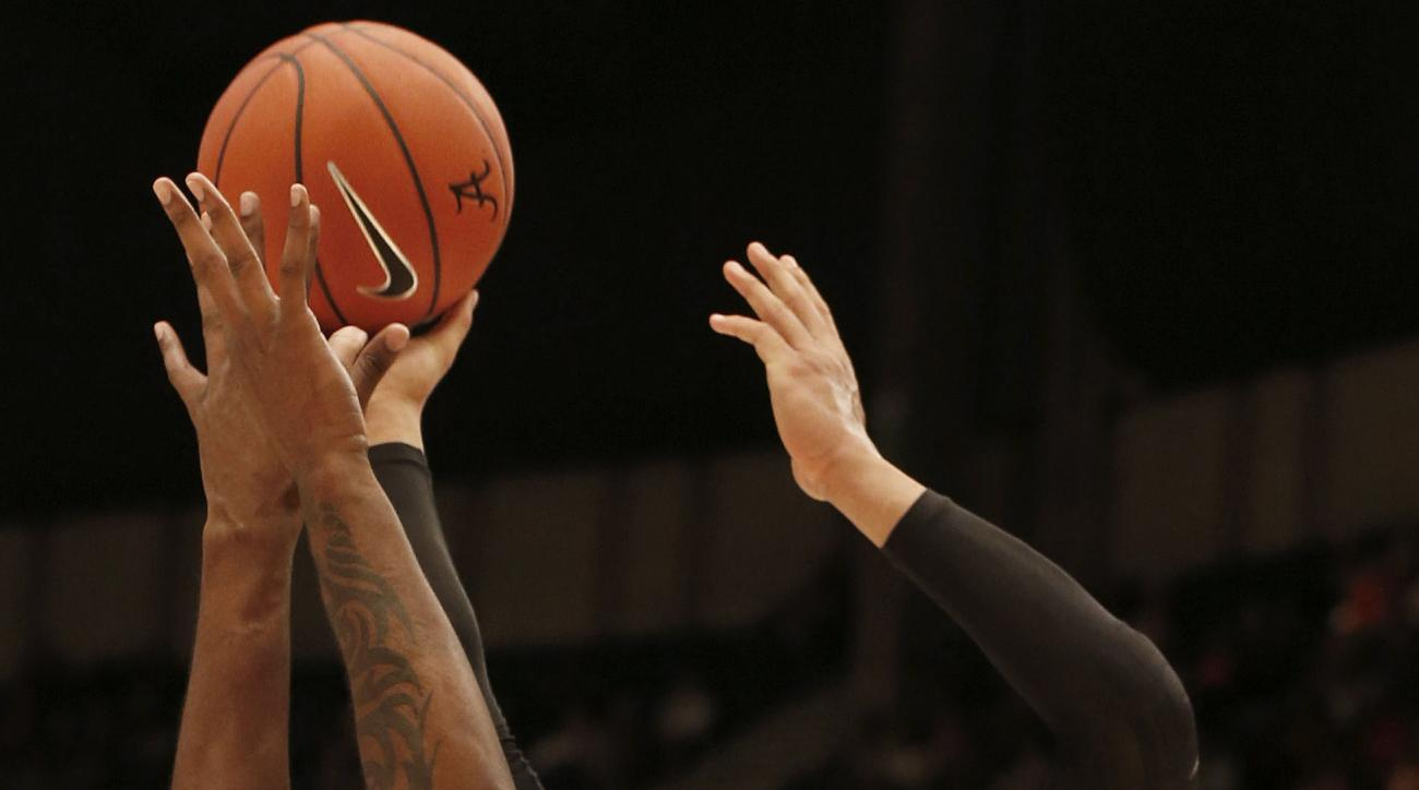 Oregon forward Dillon Brooks (24) puts up a shot over Alabama forward Jimmie Taylor (10) during the first half of an NCAA college basketball game, Monday, Dec. 21, 2015, in Birmingham, Ala. (AP Photo/Butch Dill)