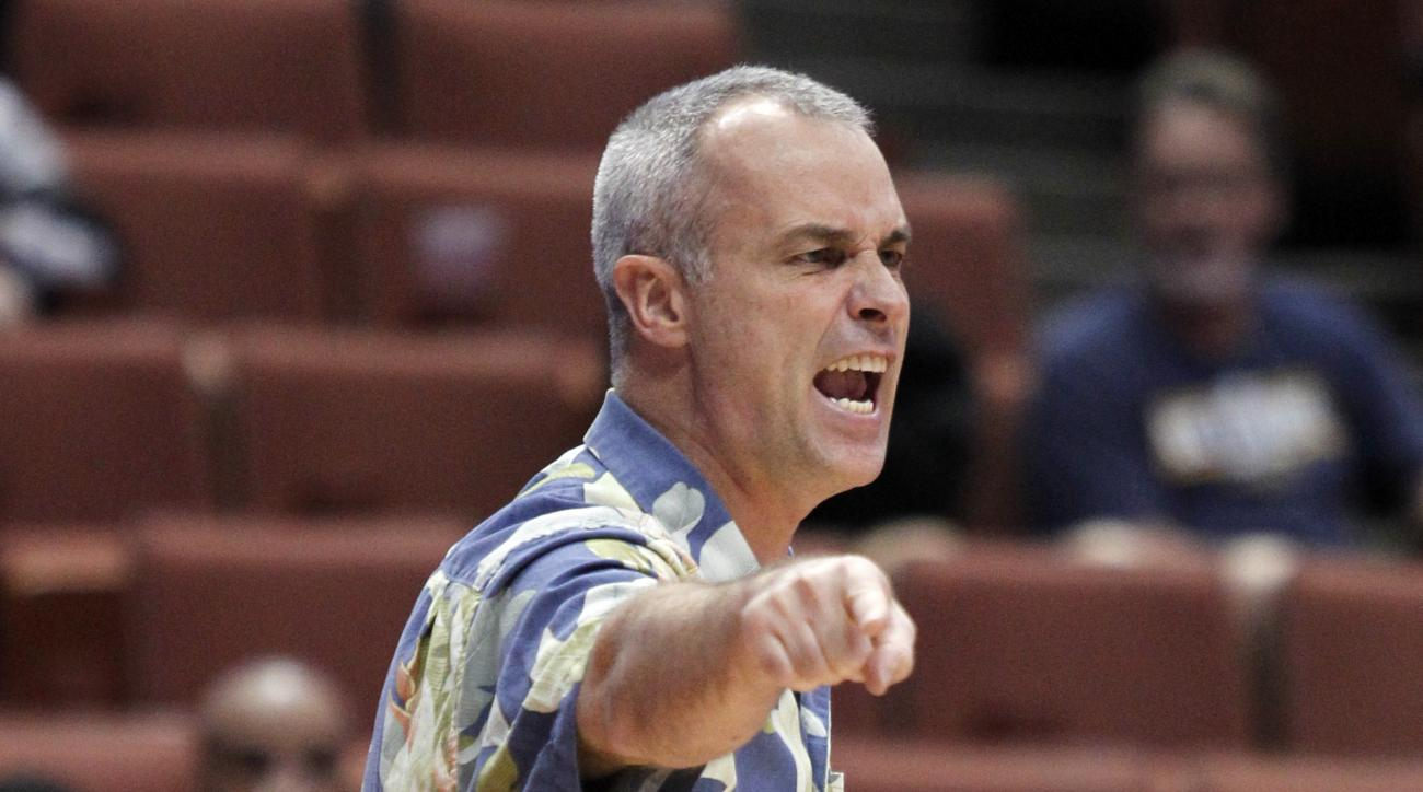FILE - In this March 13, 2014, file photo, Hawaii coach Gib Arnold talks to his players during the first half of an NCAA college basketball game against Cal State Northridge in the Big West Conference men's tournament in Anaheim, Calif. The University of