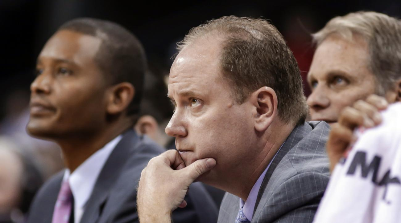 FILE - In this Nov. 15, 2015, file photo, Wisconsin associate head coach Greg Gard, center, watches the team's NCAA college basketball game against Siena in Madison, Wis. Gard, the longtime assistant, makes his debut on Wednesday as the Badgers' interim h