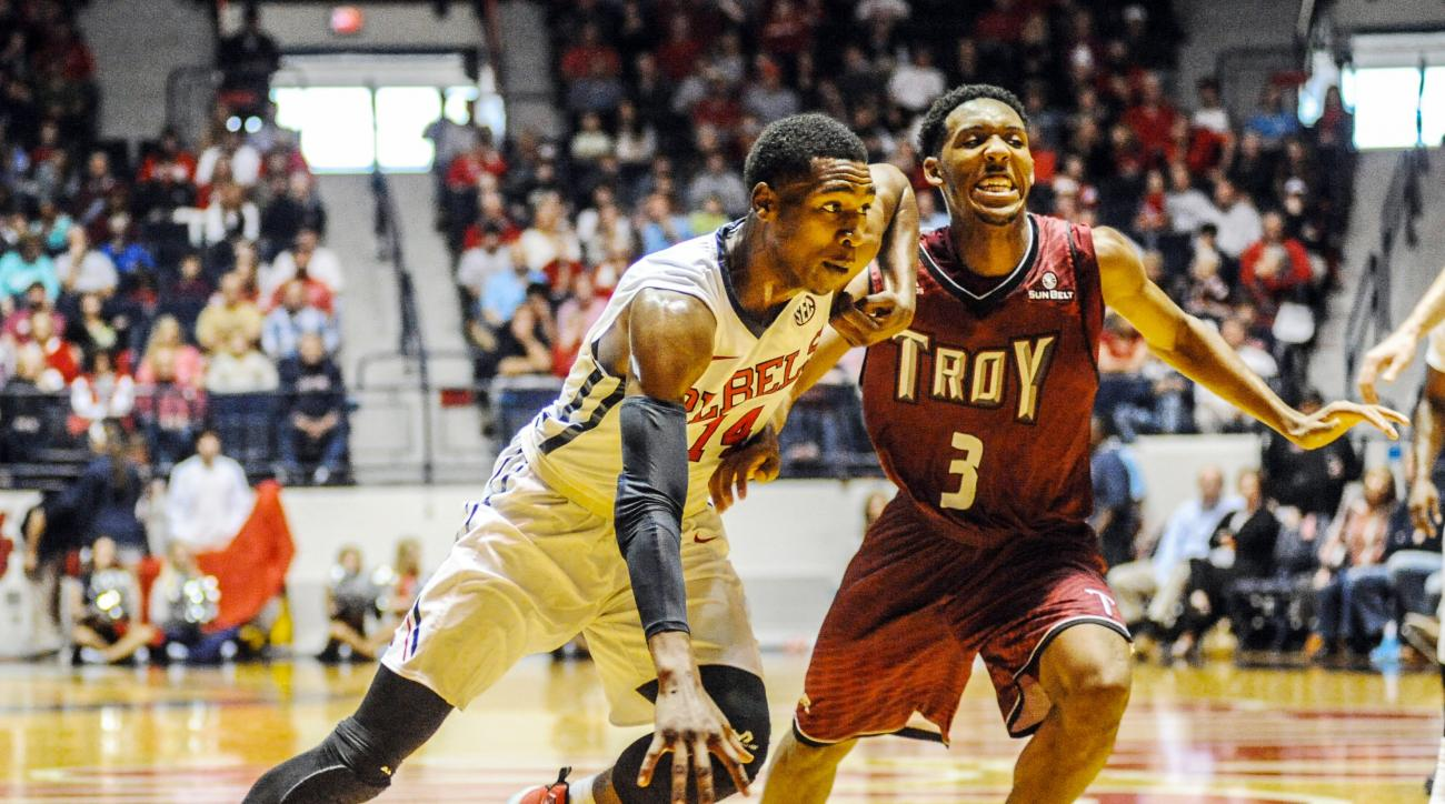 Mississippi's Rasheed Brooks (14) drives against Troy's Wesley Person (3) during an NCAA college basketball game in Oxford, Miss., Tuesday, Dec. 22, 2015. (Bruce Newman/The Oxford Eagle via AP)  NO SALES; MANDATORY CREDIT, MAGS OUT
