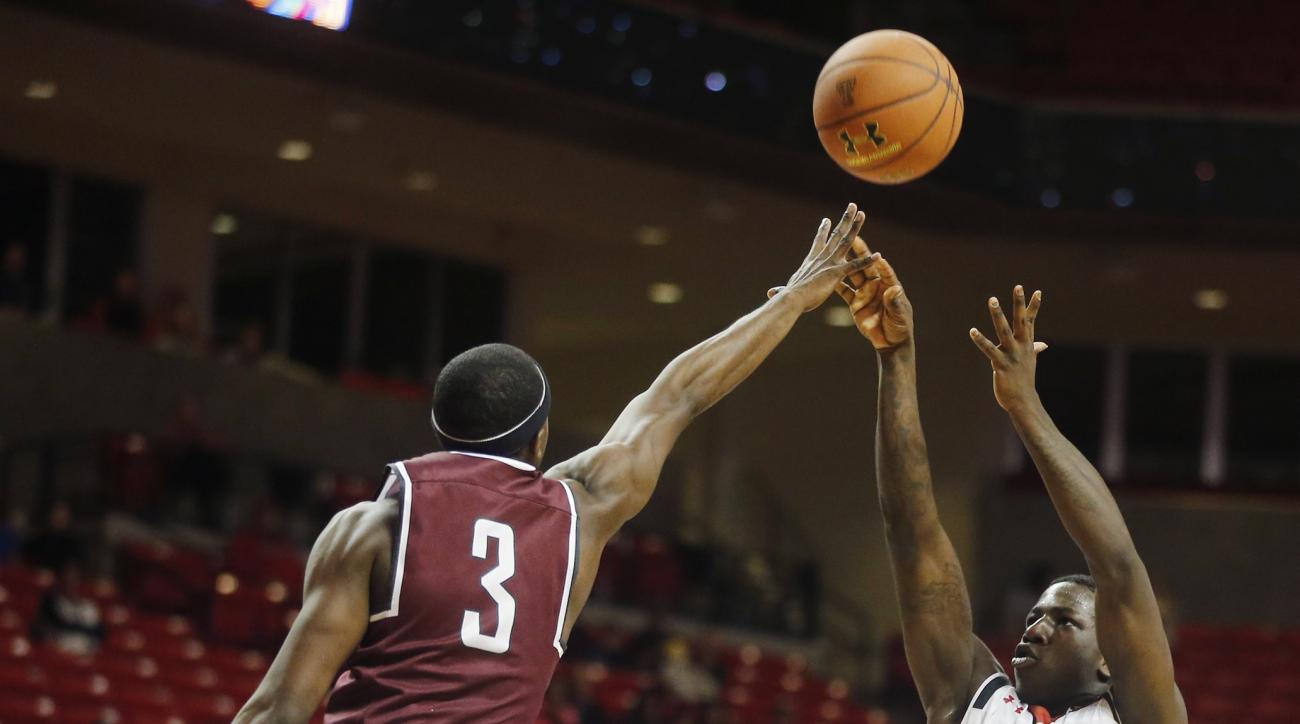 Arkansas-Little Rock guard Josh Hagins tries to block a shot by Texas Tech guard Devaugntah Williams during an NCAA college basketball game Tuesday, Dec. 22, 2015, in Lubbock, Texas. (Mark Rogers/Lubbock Avalanche-Journal via AP) ALL LOCAL TELEVISION OUT;