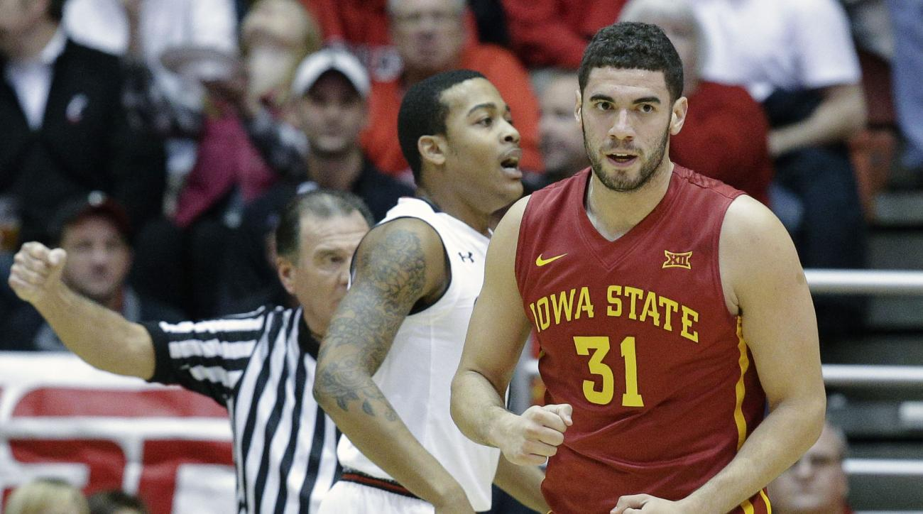 Iowa State's Georges Niang (31) reacts after scoring and drawing a foul in the first half of an NCAA college basketball game against Cincinnati, Tuesday, Dec. 22, 2015, in Cincinnati. (AP Photo/John Minchillo)