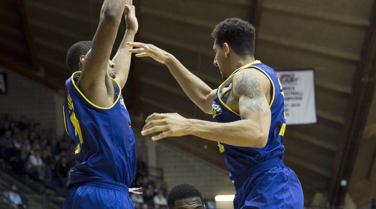 Villanova forward Darryl Reynolds, center, tries to get by Delaware forward Skye Johnson, left, and forward Marvin King-Davis in the second half of an NCAA college basketball game Tuesday, Dec. 22, 2015, in Villanova, Pa. Villanova won 78-48. (AP Photo/La