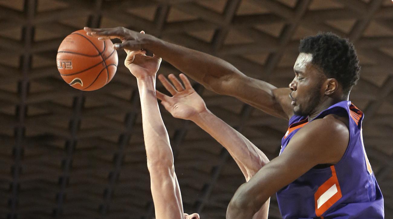 Clemson center Legend Robertin blocks a shot by Georgia forward Mike Edwards during an NCAA college basketball game Tuesday, Dec. 22, 2015, in Athens, Ga. Georgia defeated Clemson 71-48. (Curtis Compton/Atlanta Journal Constitution via AP)