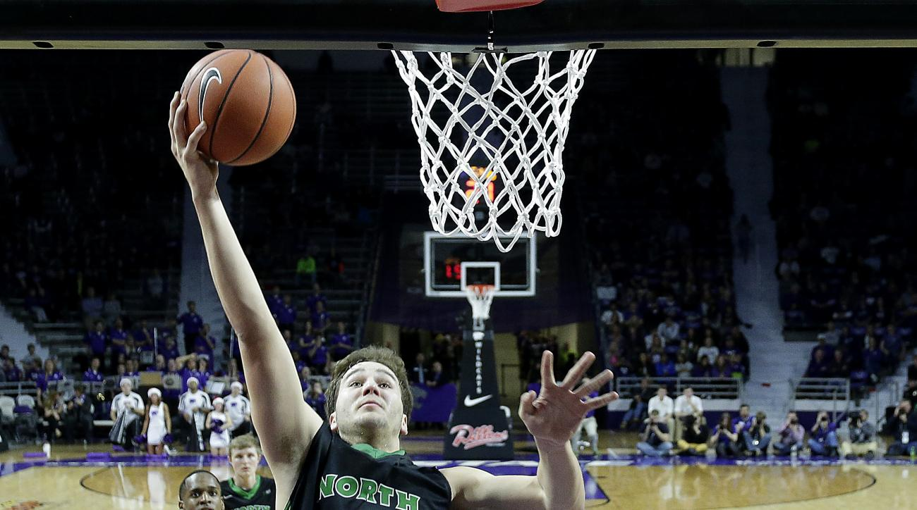 North Dakota's Conner Avants (32) gets past Kansas State's D.J. Johnson (4) to shoot during the first half of an NCAA college basketball game Tuesday, Dec. 22, 2015, in Manhattan, Kan. (AP Photo/Charlie Riedel)