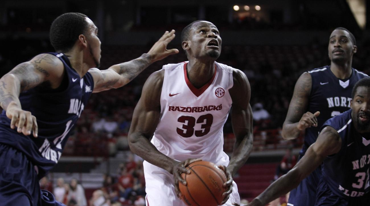 Arkansas' Moses Kingsley (33) drives up the middle during the first half of an NCAA college basketball game against North Florida, Tuesday, Dec. 22, 2015, in Fayetteville, Ark. (AP Photo/Samantha Baker)