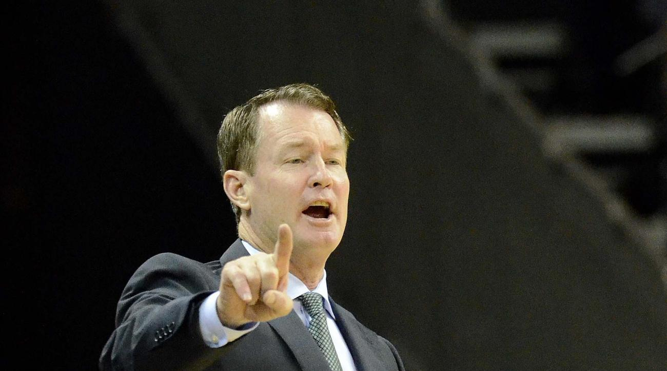 Charlotte head coach Mark Price instructs his team from the sideline during an NCAA college basketball game against Georgetown on Tuesday, Dec 22, 2015, in Charlotte, N.C. Georgetown won 62-59. (Robert Lahser/The Charlotte Observer via AP) MAGS OUT; TV OU