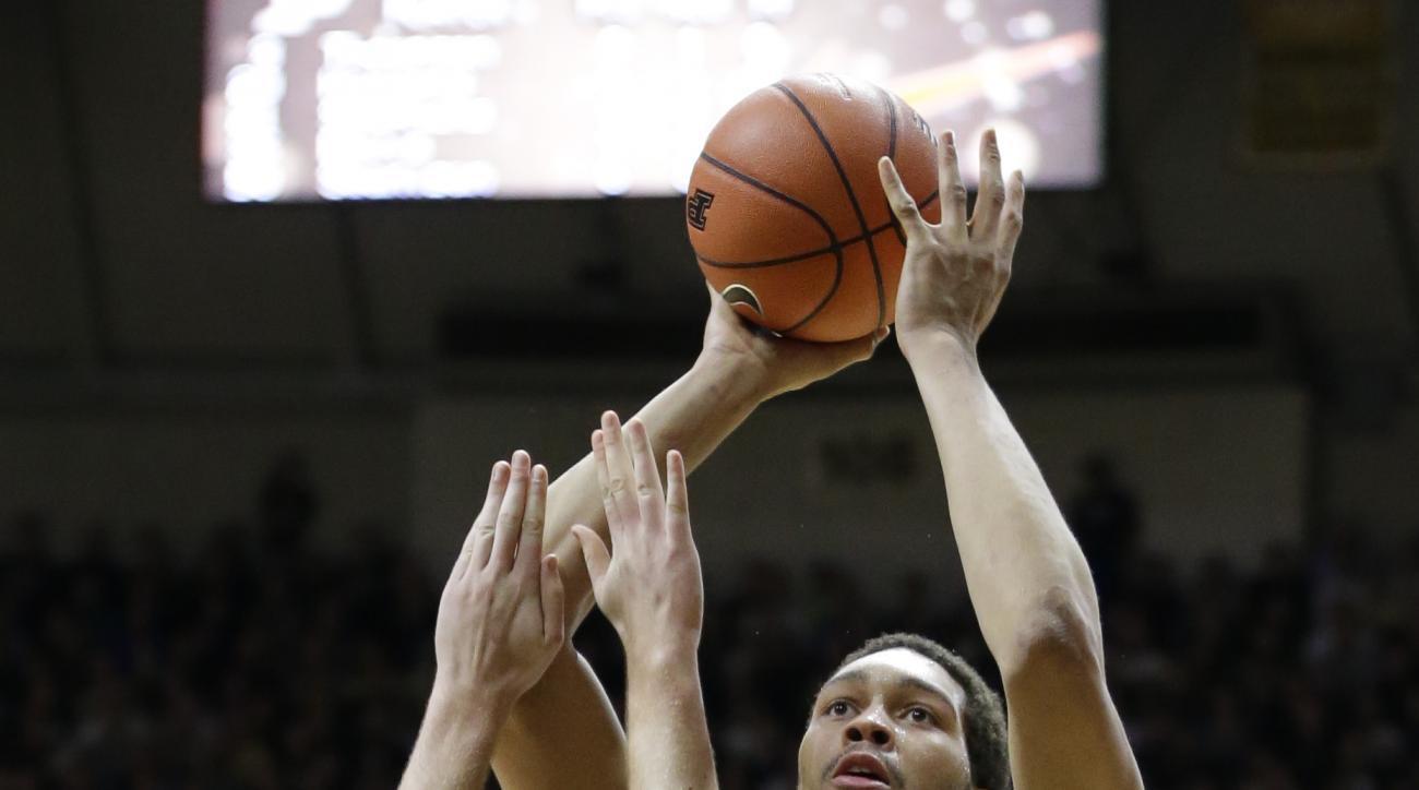 Purdue center A.J. Hammons (20) shoots over Vanderbilt center Josh Henderson (40) during the second half of an NCAA college basketball game in West Lafayette, Ind., Tuesday, Dec. 22, 2015. Purdue defeated Vanderbilt 68-55. (AP Photo/Michael Conroy)