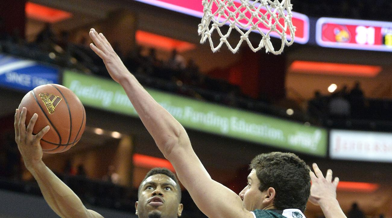 Louisville's Trey Lewis (3) shoots as Utah Valley's Andrew Bastien (42) defends during the first half of an NCAA college basketball game, Wednesday, Dec. 23, 2015, in Louisville, Ky. (AP Photo/Timothy D. Easley)