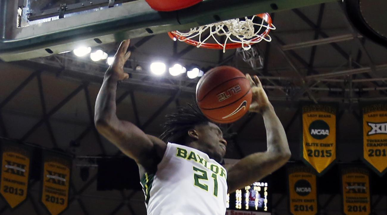 Baylor forward Taurean Prince (21) scores past New Mexico State guard Rashawn Browne (10), right, in the first half of their NCAA college basketball game, Wednesday, Dec. 23, 2015, in Waco, Texas. (AP/Rod Aydelotte)