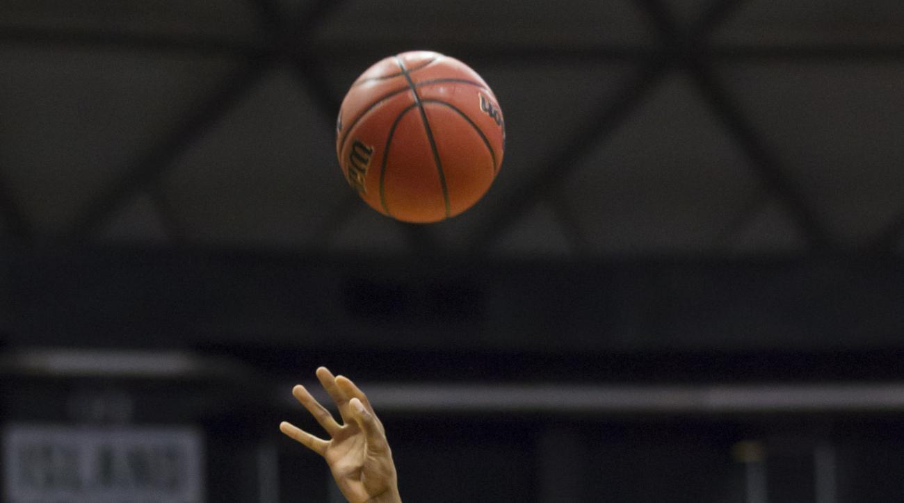 Oklahoma forward Dante Buford (21) shoots over Hawaii guard Sai Tummala during the first half of an NCAA college basketball game at the Diamond Head Classic, Wednesday, Dec. 23, 2015, in Honolulu. (AP Photo/Eugene Tanner)