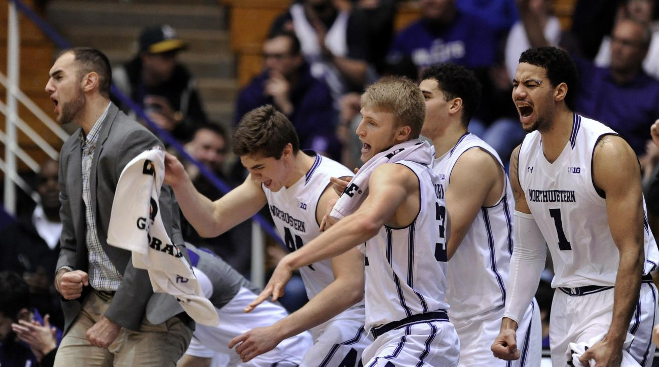 Northwestern's bench celebrates during the final minutes of the team's NCAA college basketball game against Loyola (Md.) on Sunday, Dec. 27, 2015, in Evanston, Ill. Northwestern won 74-59. (AP Photo/Paul Beaty)