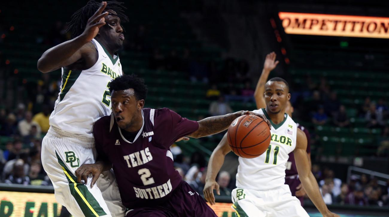 Texas Southern forward Chris Thomas (2) drives on Baylor forward Taurean Prince, left and guard Lester Medford (11) in the first half of an NCAA college basketball game, Tuesday, Dec. 29, 2015, in Waco, Texas. (AP Photo/Rod Aydelotte)