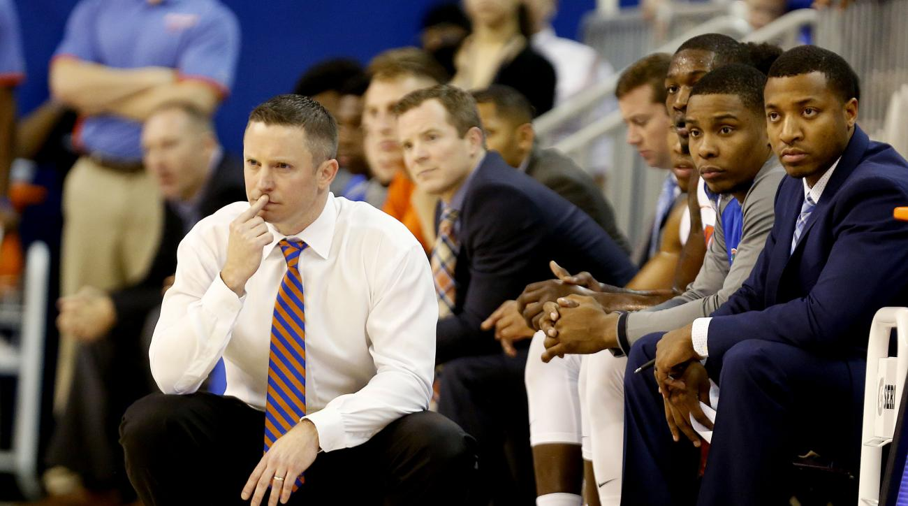 Florida head coach Mike White watches from the bench against the Florida State during the first half of an NCAA college basketball game Tuesday, Dec. 29, 2015, in Gainesville, Fla. (Matt StameyThe Gainesville Sun via AP)
