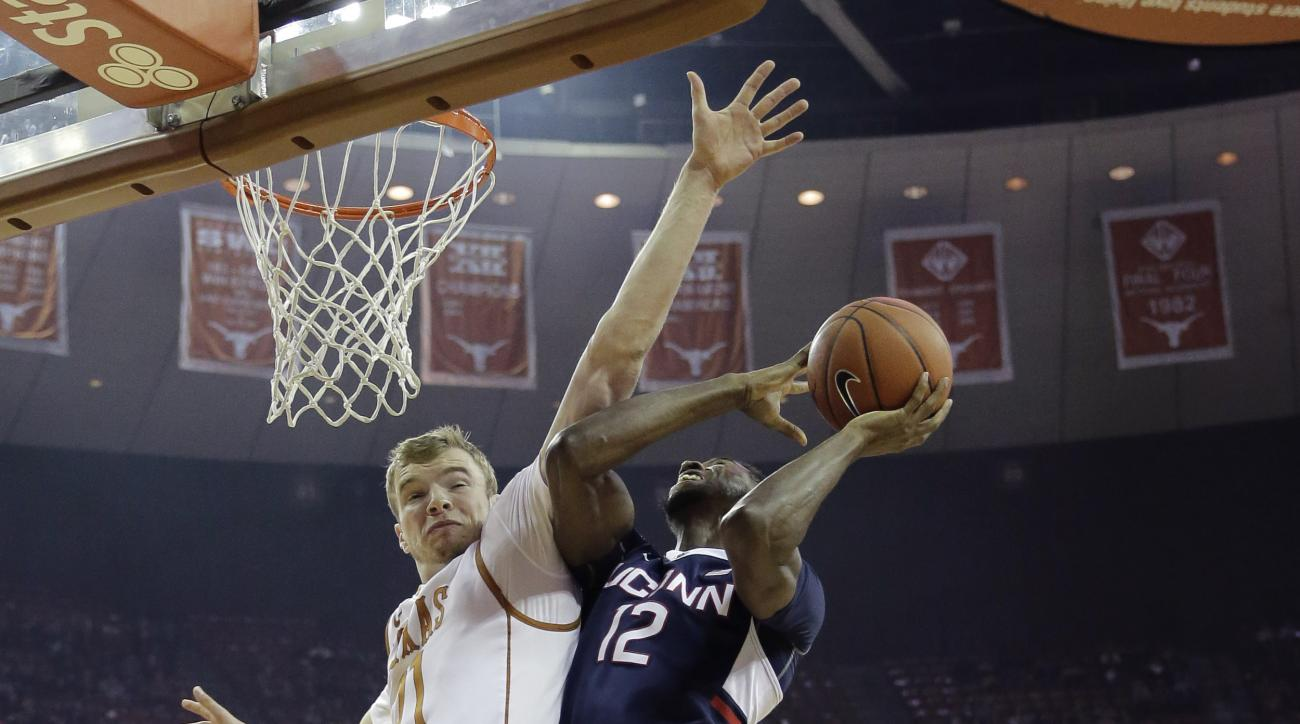 Connecticut forward Kentan Facey shoots next to Texas forward Connor Lammert (21) during the first half of an NCAA college basketball game, Tuesday, Dec. 29, 2015, in Austin, Texas. (AP Photo/Eric Gay)