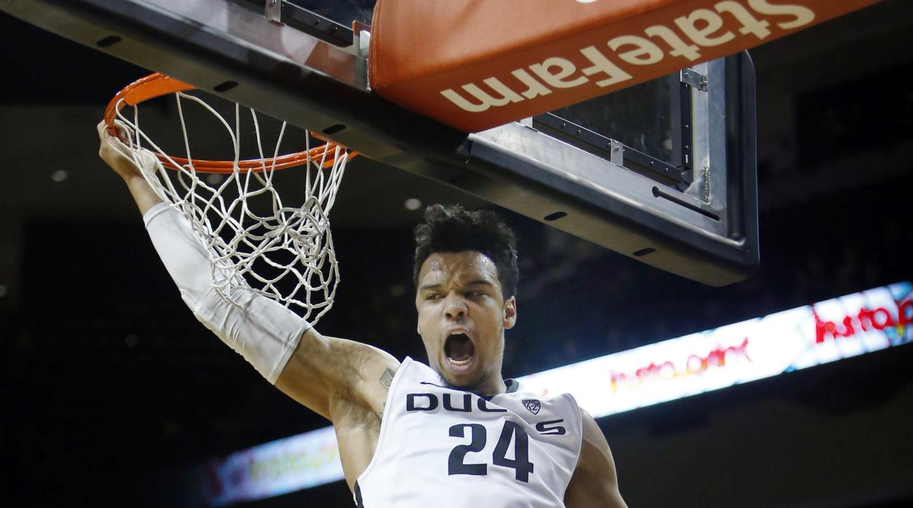 Oregon's Dillon Brooks dunks over Western Oregon's Janvier Alaby during the first half of an NCAA college basketball game Tuesday, Dec. 29, 2015, in Eugene, Ore. Oregon won 88-60. (Andy Nelson/The Register-Guard via AP)