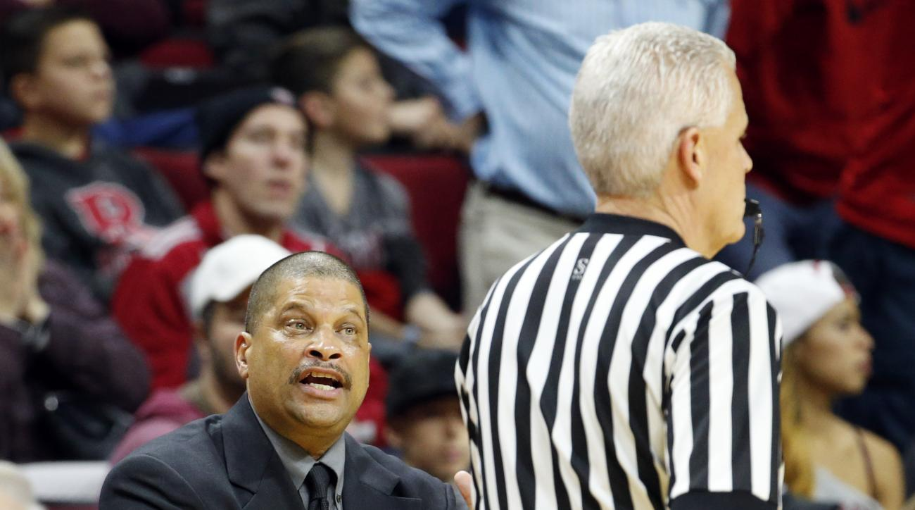 Rutgers head coach Eddie Jordan, left, talks to an official during the first half of an NCAA college basketball game against Indiana, Wednesday, Dec. 30, 2015, in Piscataway, N.J. (AP Photo/Julio Cortez)