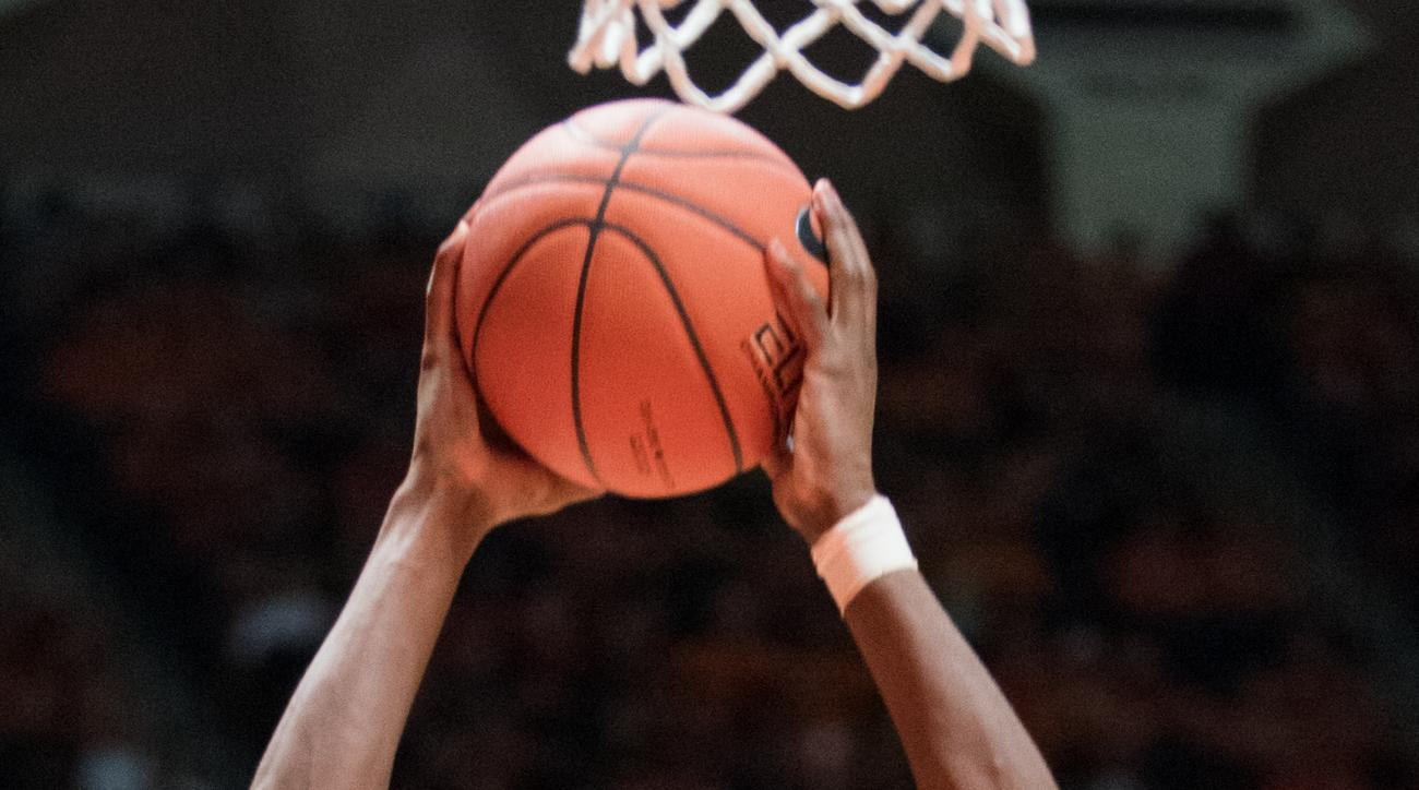 Michigan's guard Caris LeVert (23) goes up for a dunk against Illinois during the second half of an NCAA  college basketball game, Wednesday, Dec. 30, 2015, in Champaign, Ill. (AP Photo/Robin Scholz)