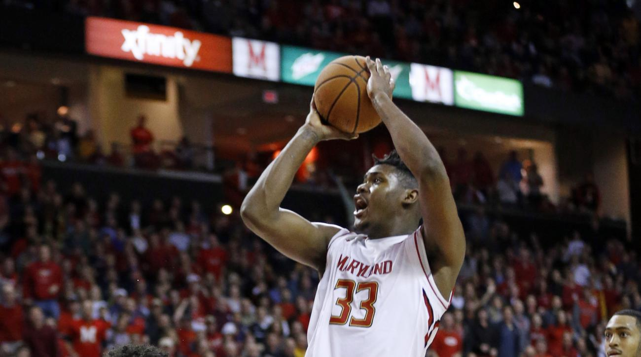 Maryland center Diamond Stone, center, shoots over Penn State guard Josh Reaves in the second half of an NCAA college basketball game, Wednesday, Dec. 30, 2015, in College Park, Md. Stone contributed a game-high 39 points to Maryland's 70-64 win. (AP Phot