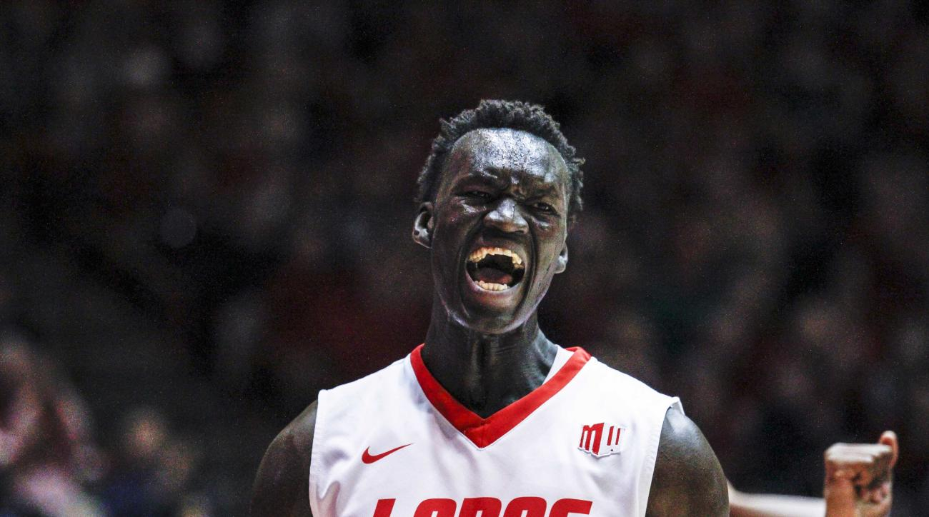 New Mexico's Obij Aget (11) celebrates a basket during the first half an NCAA college basketball game against Nevada on Wednesday, Dec. 30, 2015, in Albuquerque, N.M. (AP Photo/Juan Labreche)