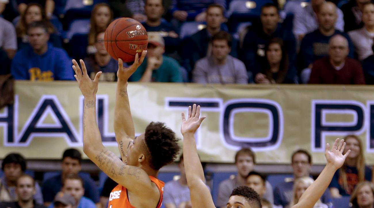 Syracuse's Malachi Richardson, left, shoots as Pittsburgh's James Robinson defends during the first half of an NCAA college basketball game Wednesday, Dec. 30, 2015, in Pittsburgh. (AP Photo/Keith Srakocic)