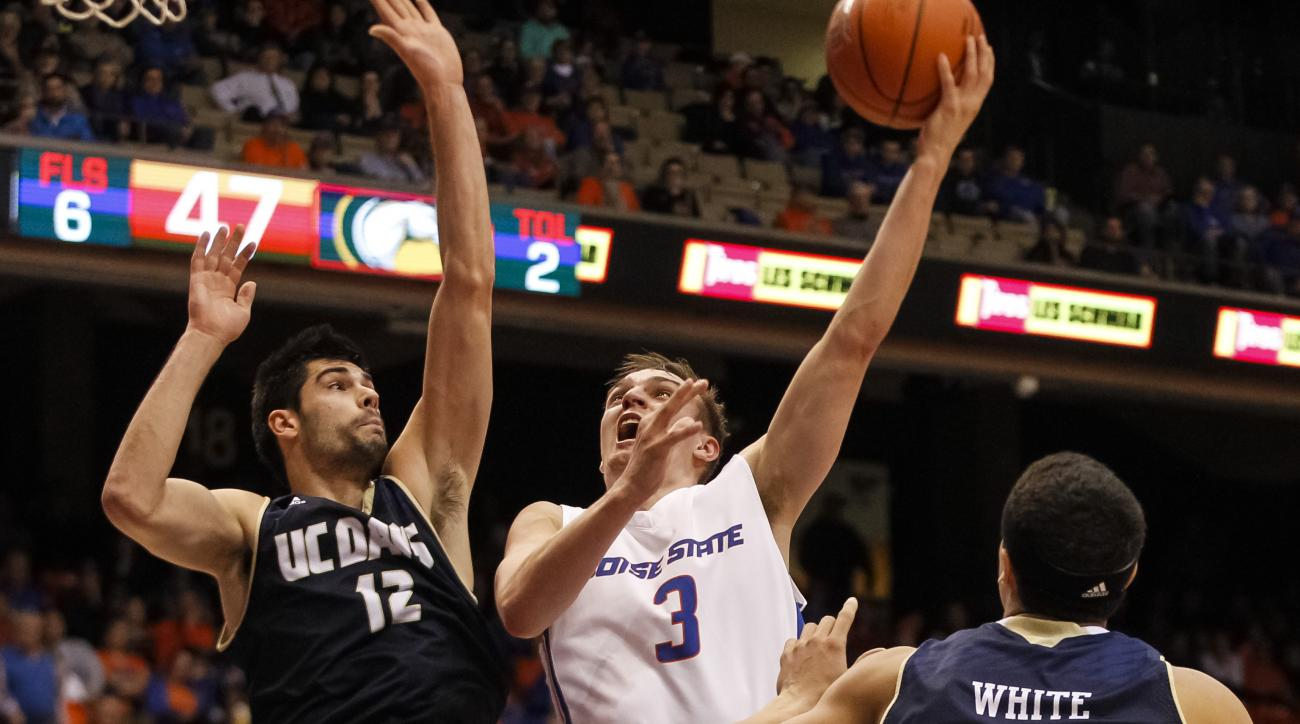 Boise State's Anthony Drmic (3) shoots past UC Davis' Georgi Funtarov (12) during the second half of an NCAA college basketball game in Boise, Idaho, Wednesday, Dec. 30, 2015. Boise State won 64-56. (AP Photo/Otto Kitsinger)