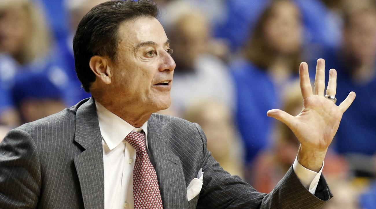 FILE - In this Dec. 26, 2015, file photo, Louisville head coach Rick Pitino calls a play during the second half of an NCAA college basketball game against Kentucky in Lexington, Ky. Pitino says the NCAA has not interviewed him about an escort's book on al