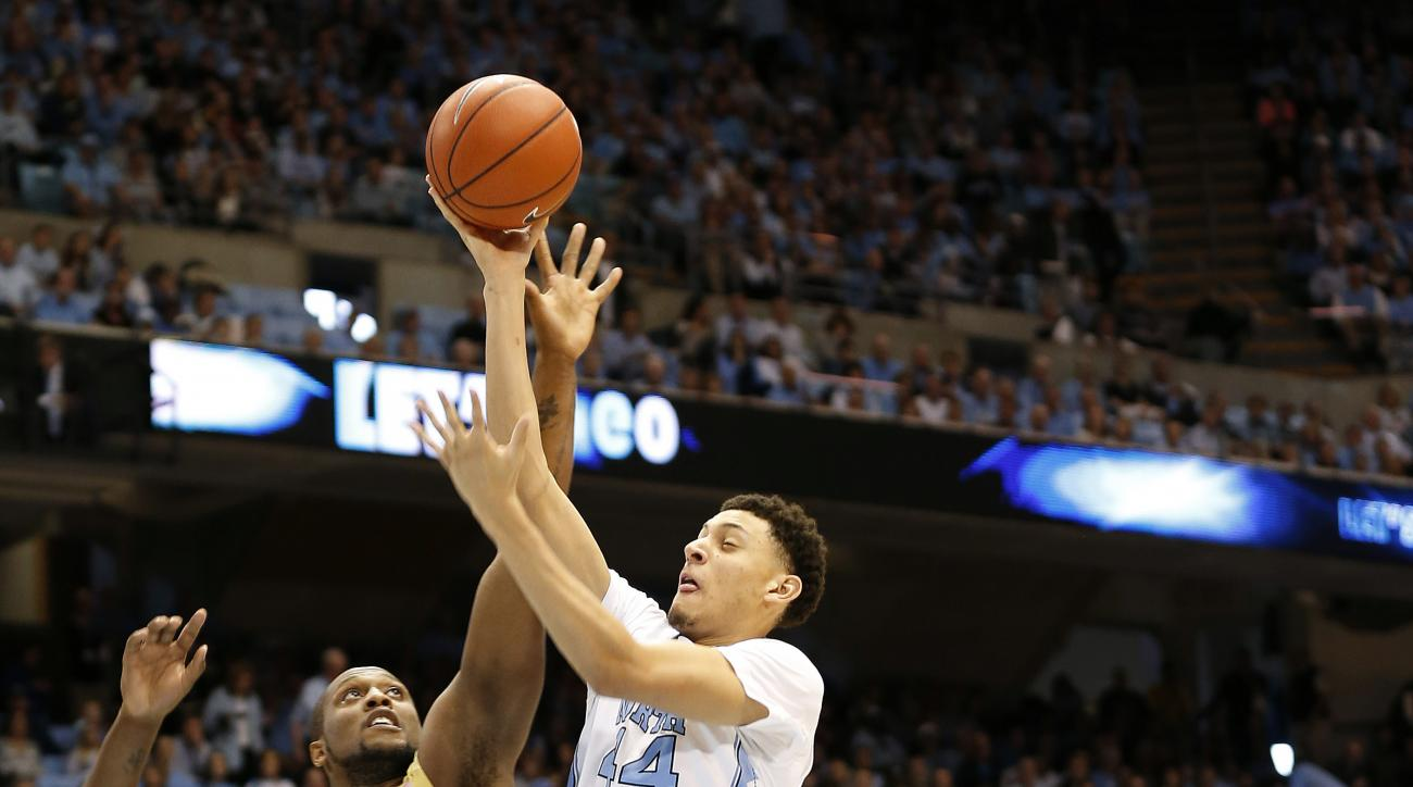 North Carolina's Justin Jackson (44) goes to the basket under pressure from Georgia Tech's Charles Mitchell (0) and Marcus Georges-Hunt, right, during the first half of an NCAA basketball game, Saturday, Jan. 2, 2016, in Chapel Hill, N.C. (AP Photo/Ellen