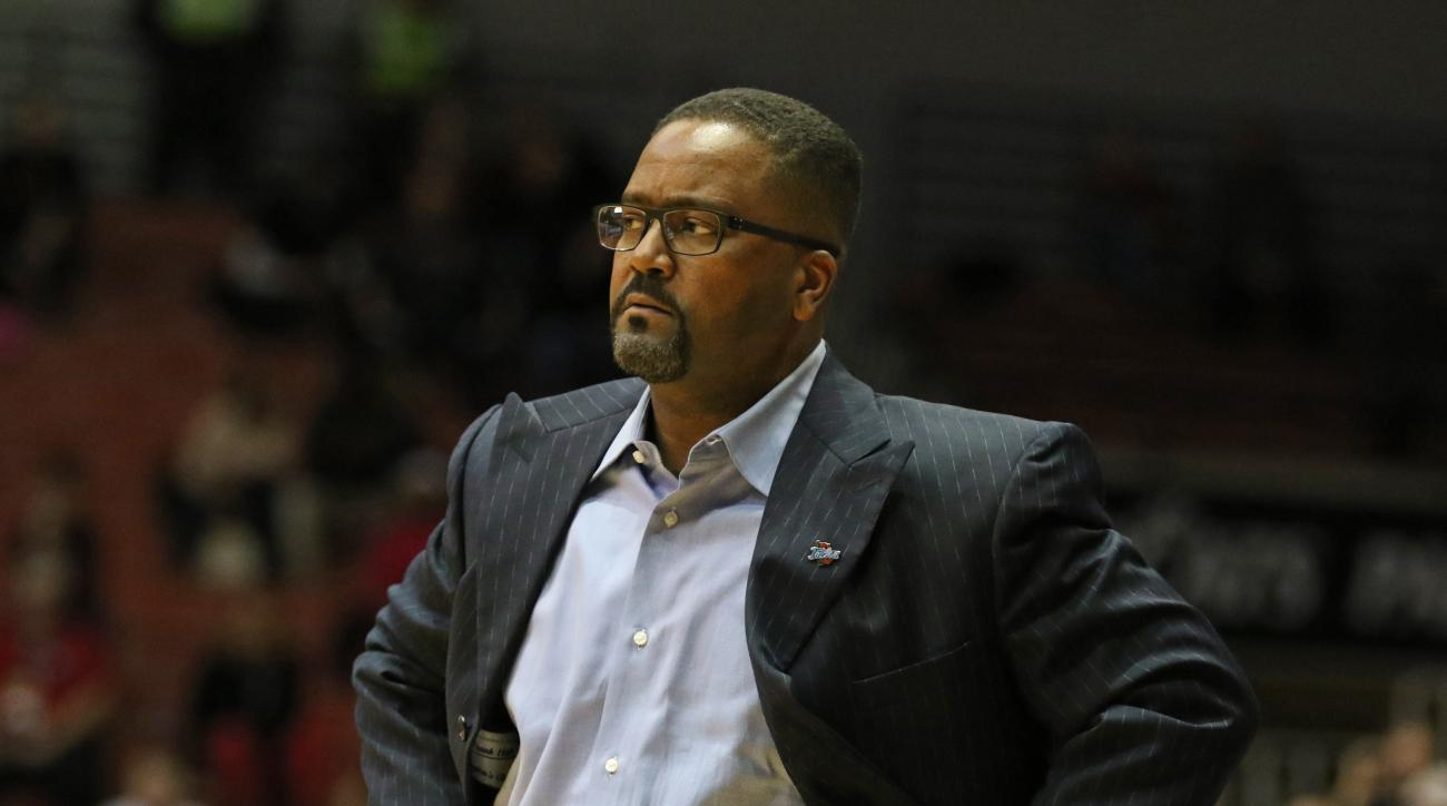Tulsa head coach Frank Haith glares at one of his players following a foul during the first half of an NCAA college basketball game against Cincinnati Saturday, Jan. 2, 2016, in Cincinnati.  (AP Photo/Gary Landers)