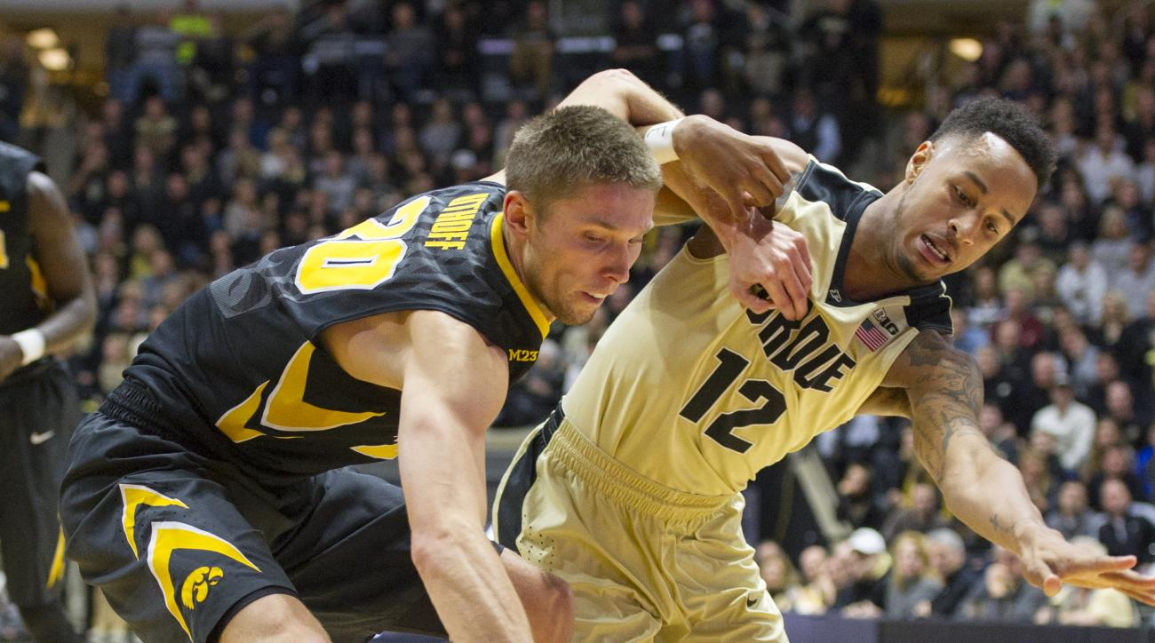 Iowa forward Jarrod Uthoff, left, battles for control of the ball against Purdue forward Vince Edwards, right, during the first half of an NCAA college basketball game, Jan. 2, 2016, in West Lafayette, Ind. (AP Photo/Doug McSchooler)