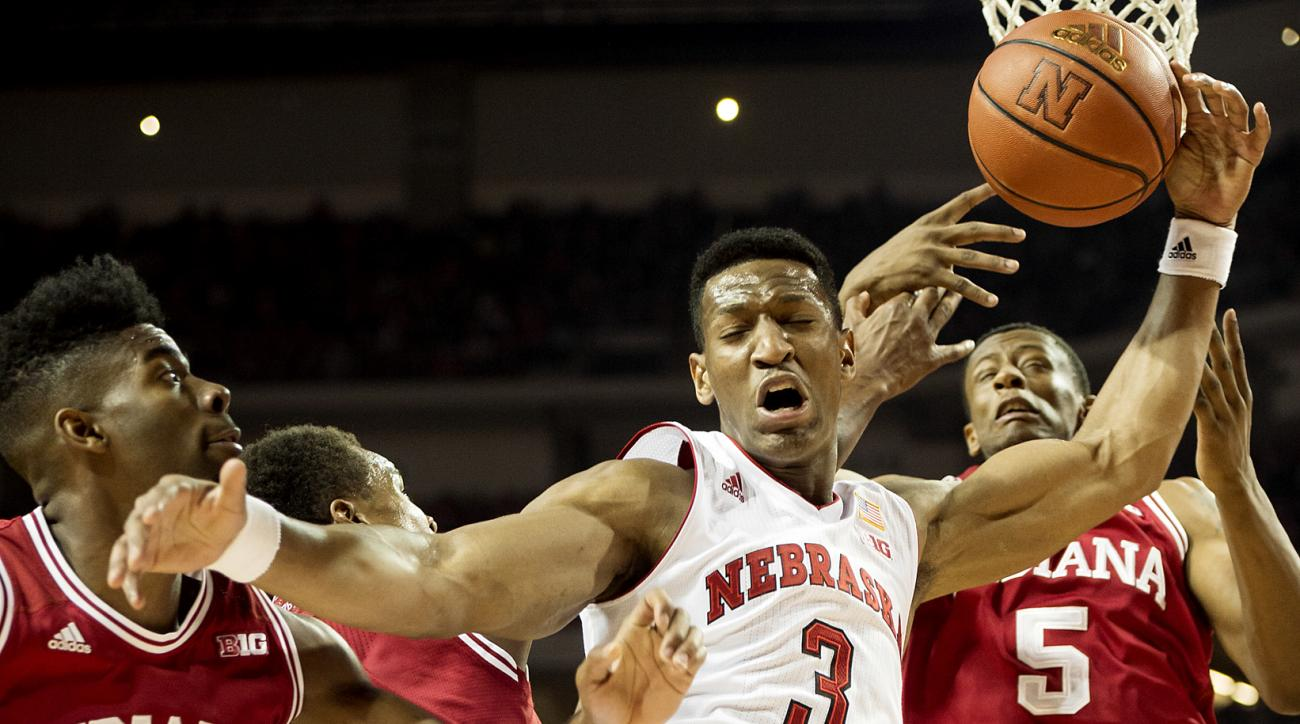 Nebraska guard Andrew White (3) is fouled going for a rebound in front of Indiana's Robert Johnson (4), James Blackmon Jr. and Troy Williams (5) during the second half of an NCAA college basketball game, Saturday, Jan. 2, 2016, at Pinnacle Bank Arena in L