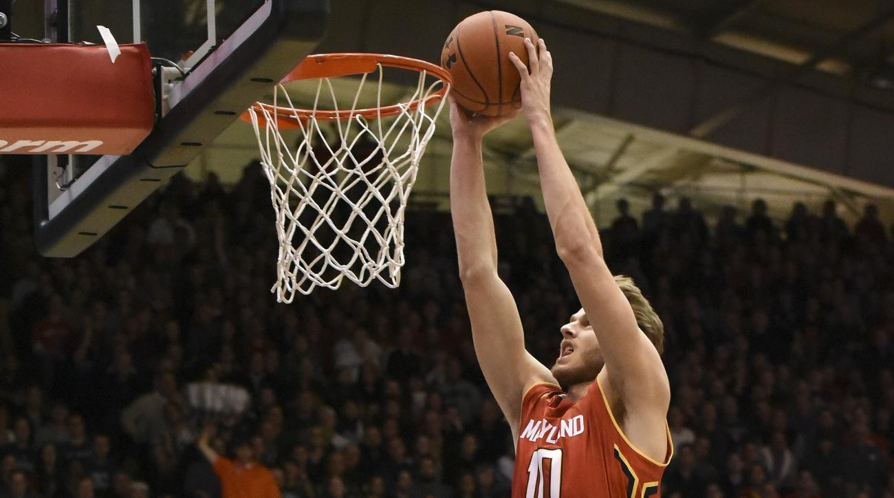 Maryland forward Jake Layman (10) goes up for a dunk against Northwestern during the first half of an NCAA college basketball game Saturday, Jan. 2, 2016, in Evanston, Ill. (AP Photo/David Banks)