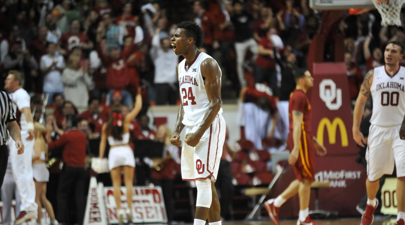 Oklahoma guard Buddy Hield (24) celebrates his team's win over Iowa State during the second half of an NCAA college basketball game in Norman, Okla., Saturday, Jan. 2, 2016. Oklahoma won the game 87-83. (AP Photo/Kyle Phillips)