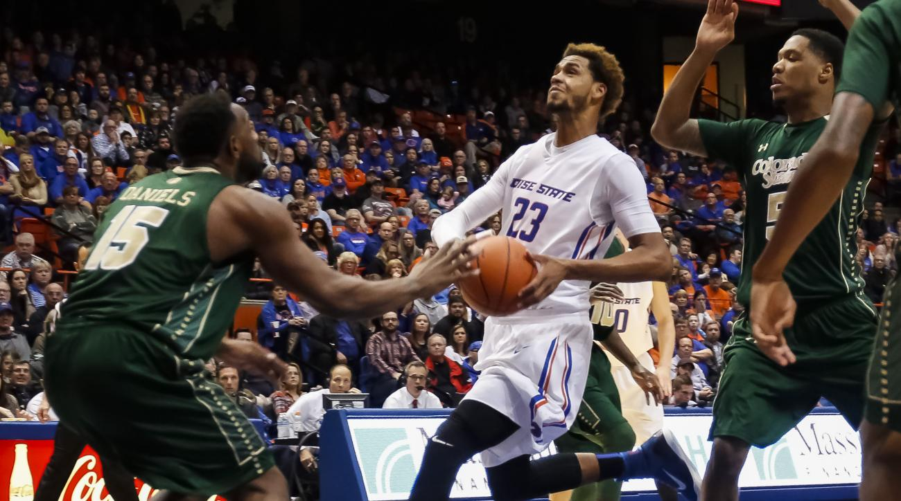 Boise State's James Webb III (23) looks to the basket as Colorado State's Tiel Daniels (15) defends during the second half of an NCAA college basketball game in Boise, Idaho, on Saturday, Jan. 2, 2016. Boise State won 84-80. (AP Photo/Otto Kitsinger)