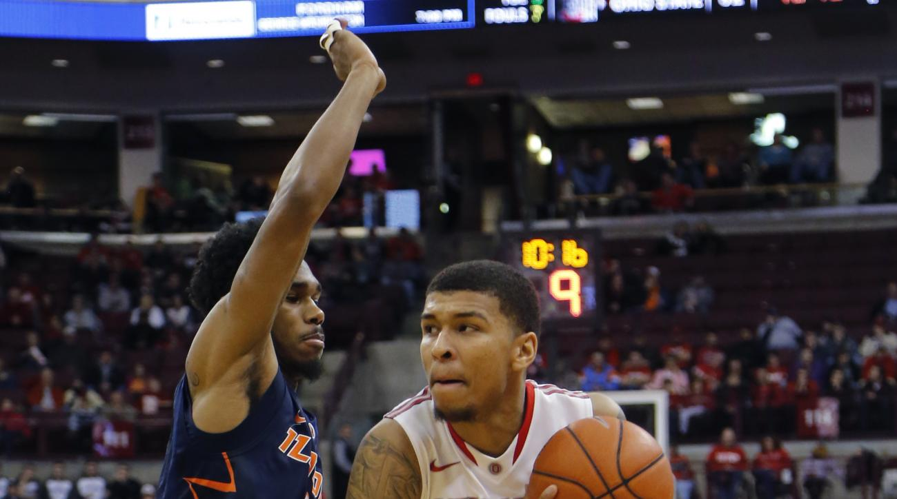 Ohio State's Marc Loving, right, drives the lane against Illinois' Jaylon Tate during the second half of an NCAA college basketball game Sunday, Jan. 3, 2016, in Columbus, Ohio. (AP Photo/Jay LaPrete)