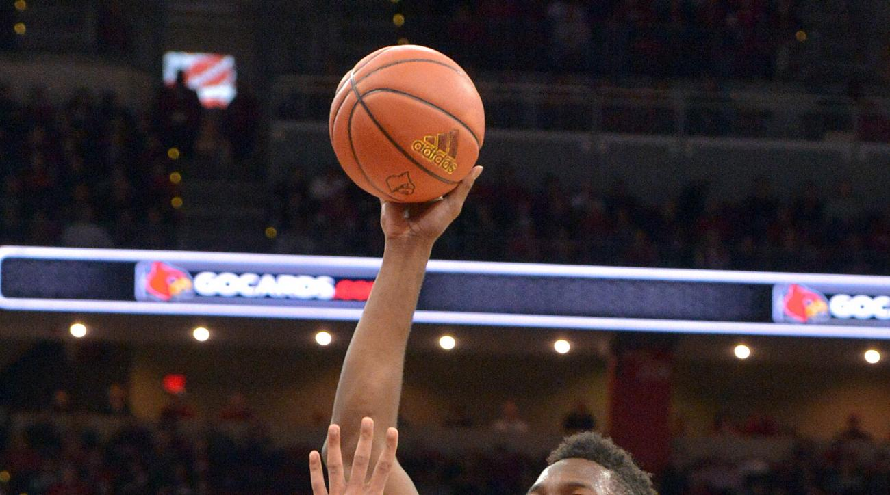 Louisville's Chinanu Onuaku (32) shoots over Wake Forest's Devin Thomas (2) during the second half of an NCAA college basketball game, Sunday, Jan. 3, 2016, in Louisville, Ky. Louisville won 65-57. (AP Photo/Timothy D. Easley)