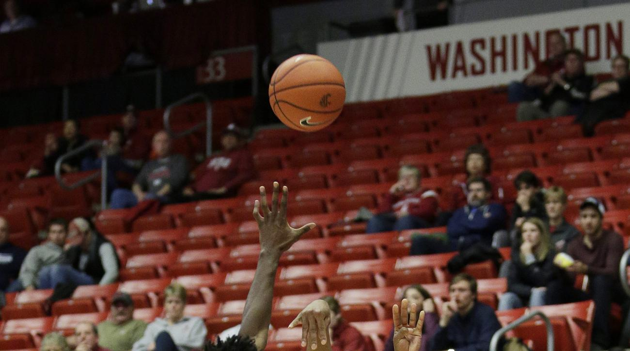 Washington State's Renard Suggs (1) shoots against UCLA's Isaac Hamilton during the first half of an NCAA college basketball game, Sunday, Jan. 3, 2016, in Pullman, Wash. (AP Photo/Young Kwak)