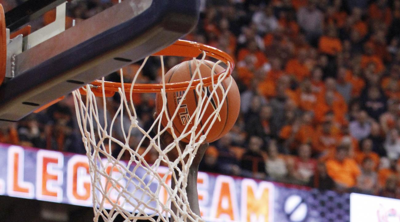 Clemson's Sidy Djitte scores during the first half of an NCAA college basketball game against Syracuse in Syracuse, N.Y., Tuesday, Jan. 5, 2016. (AP Photo/Nick Lisi)