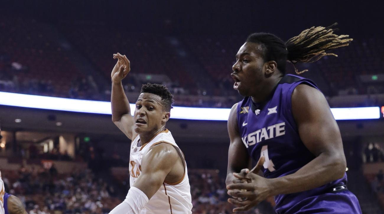 Texas guard Demarcus Holland (2) knocks the ball away from Kansas State forward D.J. Johnson (4) during the first half of an NCAA college basketball game, Tuesday, Jan. 5, 2016, in Austin, Texas. (AP Photo/Eric Gay)