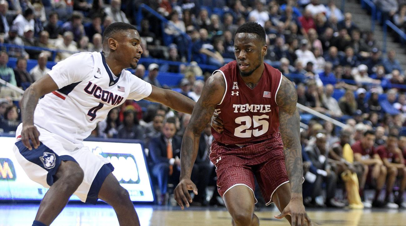 Temple's Quenton DeCosey (25) drives past Connecticut's Sterling Gibbs (4) during the first half of an NCAA college basketball game in Hartford, Conn., on Tuesday, Jan. 5, 2016. (AP Photo/Fred Beckham)
