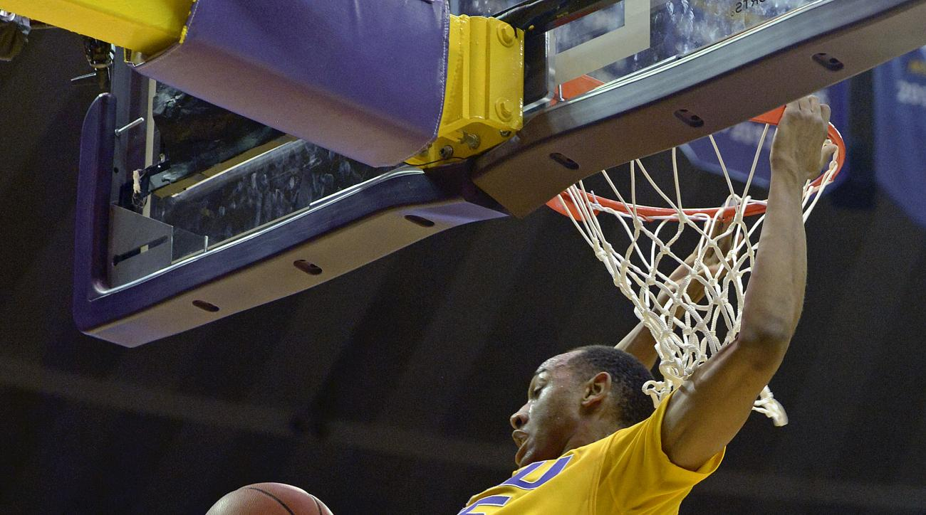 LSU guard Tim Quarterman (55) dunks the ball as Kentucky guard Isaiah Briscoe (13) and LSU forward Craig Victor II (32) watch in the first half of an NCAA college basketball game in Baton Rouge, La., Tuesday, Jan. 5, 2016. (AP Photo/Bill Feig)