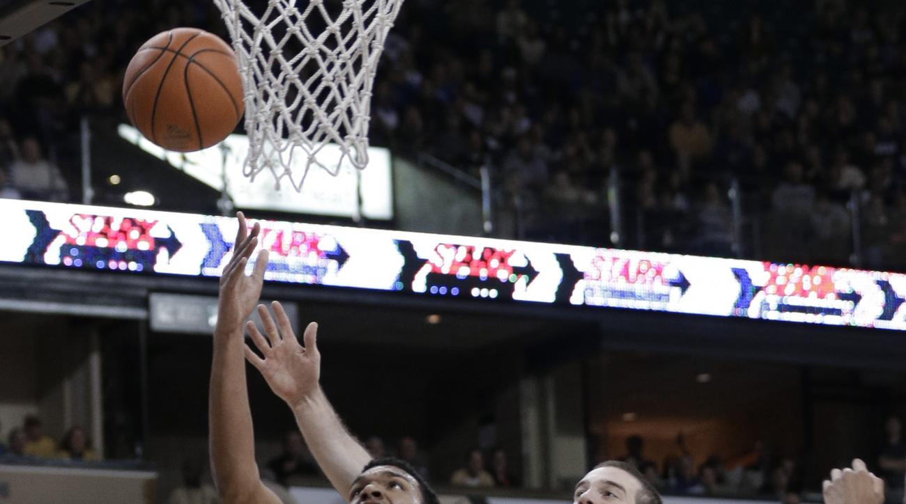 Wake Forest forward Devin Thomas (2) drives past Duke center Marshall Plumlee (40) during the first half of an NCAA college basketball game in Winston-Salem, N.C., Wednesday, Jan. 6, 2016. (AP Photo/Chuck Burton)