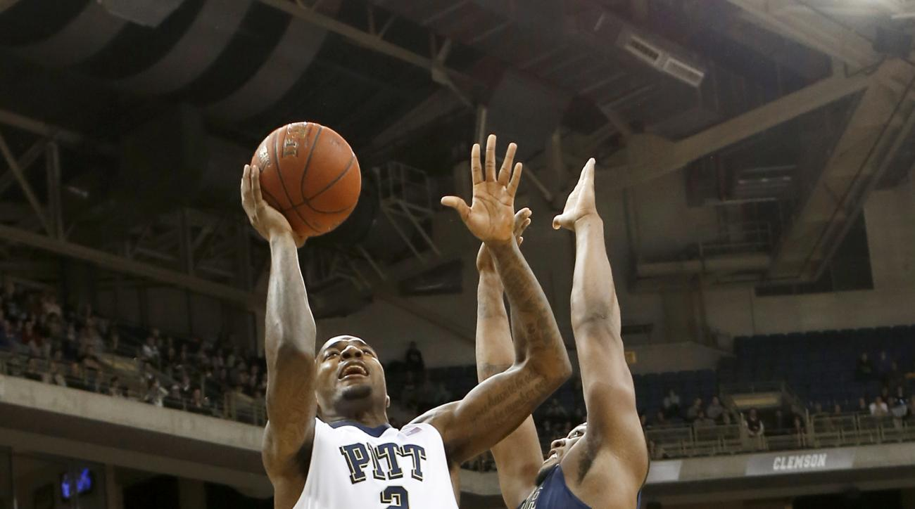 Pittsburgh's Michael Young (2) shoots over Georgia Tech's Charles Mitchell during the first half of an NCAA college basketball game, Wednesday, Jan. 6, 2016, in Pittsburgh.  (AP Photo/Keith Srakocic)