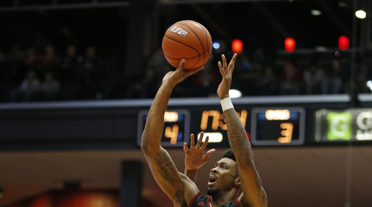 Massachusetts guard Donte Clark (0) shoots in front of Dayton Charles Cooke during the first half of an NCAA college basketball game Wednesday, Jan. 6, 2016, in Dayton, Ohio.  (AP Photo/Gary Landers)