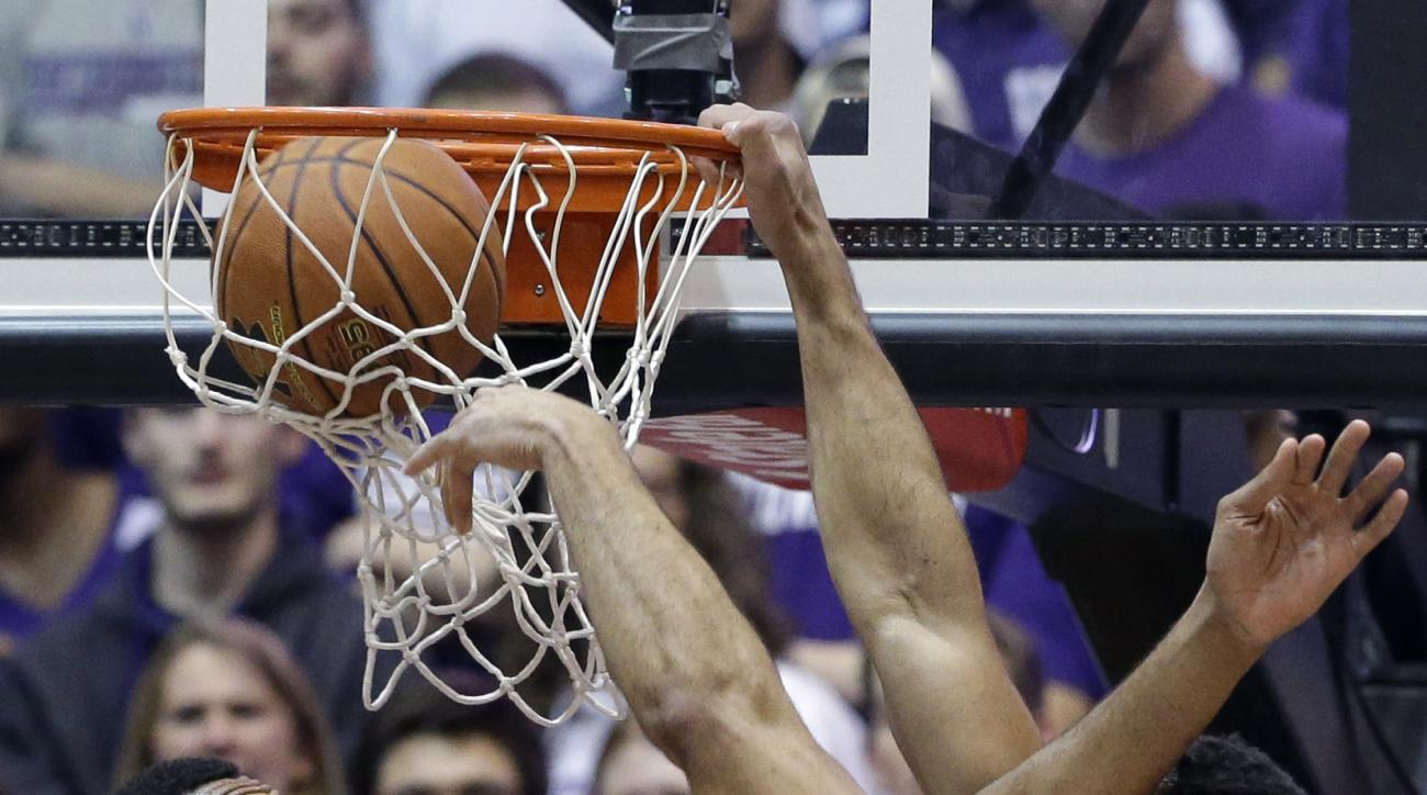 Northwestern center Joey van Zegeren, right, dunks against Ohio State center Trevor Thompson during the first half of an NCAA college basketball game on Wednesday, Jan. 6, 2016, in Evanston, Ill. (AP Photo/Nam Y. Huh)