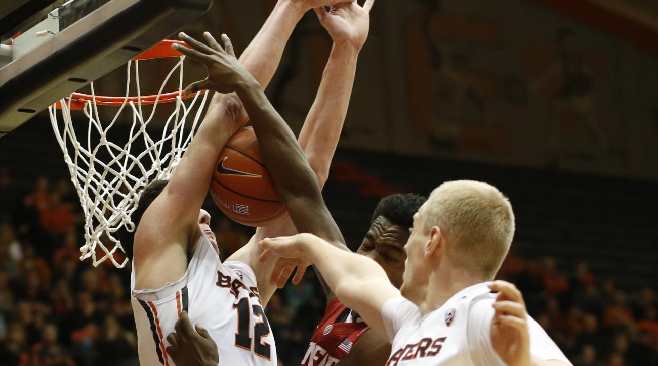 Stanford's Marcus Allen, center, has his shot blocked by Oregon State's Drew Eubanks during the first half of an NCAA college basketball game in Corvallis, Ore., on Wednesday, Jan. 6, 2016. (AP Photo/Timothy J. Gonzalez)