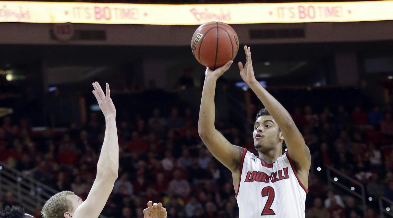 Louisville's Quentin Snider (2) shoots over North Carolina State's Abdul-Malik Abu (0) and Maverick Rowan during the second half of an NCAA college basketball game in Raleigh, N.C., Thursday, Jan. 7, 2016. Louisville won 77-72. (AP Photo/Gerry Broome)
