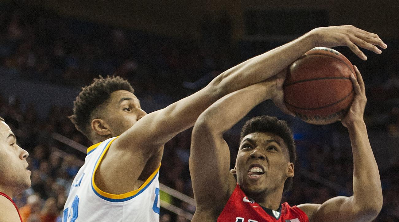 UCLA's Jonah Bolden tries to stop Arizona's Allonzo Trier during an NCAA college basketball game Thursday night, Jan. 7, 2016, in Los Angeles. (Kevin Sullivan/The Orange County Register via AP)