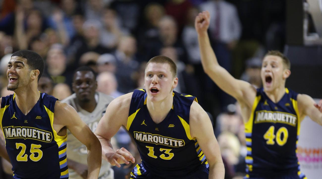FILE - In this Jan. 5, 2016, file photo, Marquette forward Henry Ellenson (13) brings the ball up court after pulling in a defensive rebound after Providence guard Kris Dunn missed the final shot of the game as time runs out in the second half of their NC